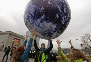 565997-environmental-activists-play-with-a-giant-globe-on-the-streets-in-a-rally-demanding-more-action-to-b